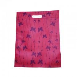 Lot de 12 sacs intissés de couleur rose foncé papillons - 61130